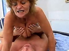 Redhaired mature serves two guys