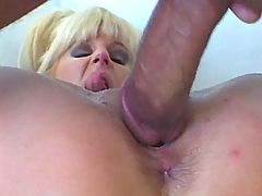 Blonde milf gets facial after fuck