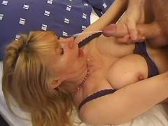Busty mature in stockings gets cum after fuck